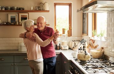 Cropped shot of a senior couple dancing in the kitchen at home