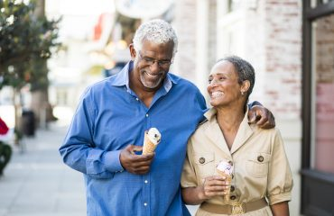 A senior african american couple enjoy an date on the town with ice cream