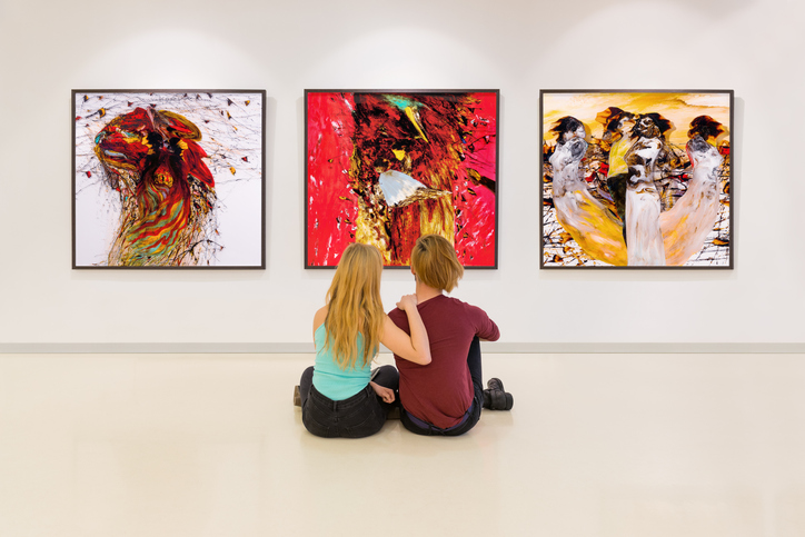 Young couple visits an art gallery